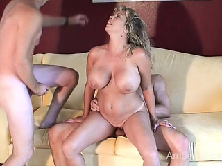 Hot swinger MILF sucks together with fucks 2 guys