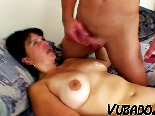 Young man fucks sexy together with curvy MILF!