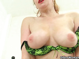 British milf Peppery strips off and lean to fucks