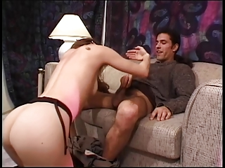 Long legged whore sticks cock down her throat on couch