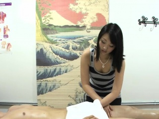 Asian masseuse tugging and cocksucking purchaser