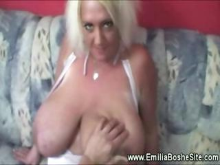 Big titted slut gives blowjob to guy