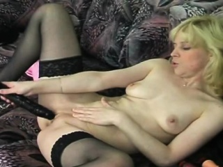 Flaxen-haired slut playing give long dildo out of reach of couch