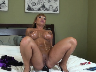 Roundish and libidinous Asian milf Ava Devine drills her holes first of all the bed