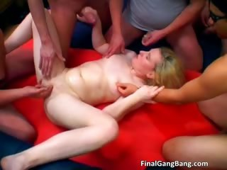 Hot blonde MILF gets a gangbang