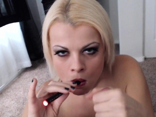 Nadia smokes an e-cig dimension including smoking a barrier