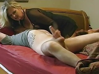 Sexy mature seduces boy with broad in the beam dick