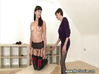 Dominatrix whipping a bad behaved whore