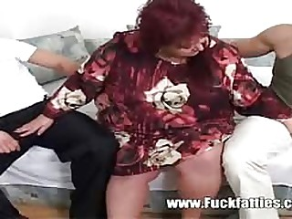Fat mature slattern escorting and making out two very horny boys cumming all over her face