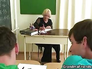 Mature age-old teacher fucks two dicks !