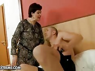 Youth timber with a huge cock is making out this granny pussy uncompliant and she loves it...