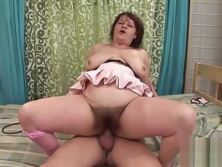 Fat full-grown slut rides a stiff bushwa
